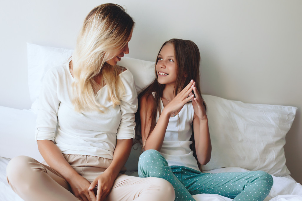 mom and daughter talking
