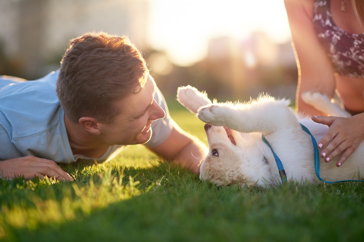 puppy and owners outdoors